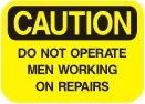 do not operate men working on repairs